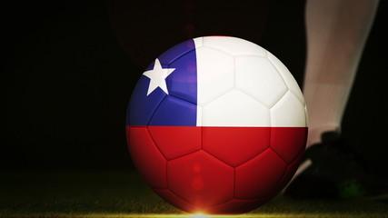 Football player kicking chile flag ball