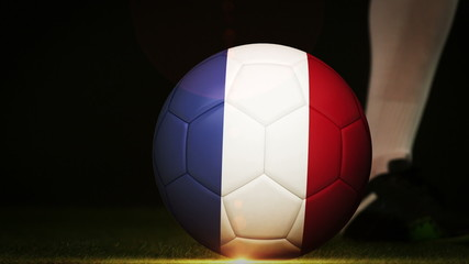 Football player kicking france flag ball