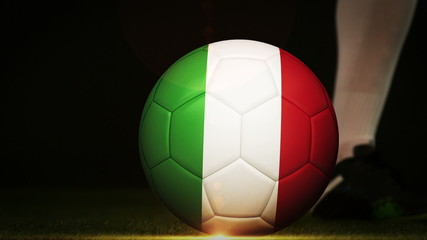 Football player kicking italy flag ball