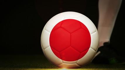 Football player kicking japan flag ball