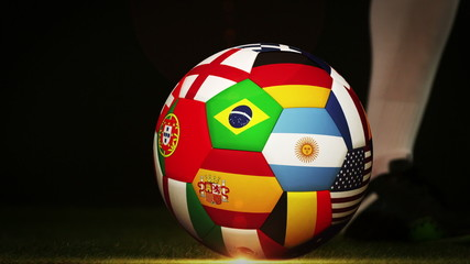 Football player kicking international flag ball