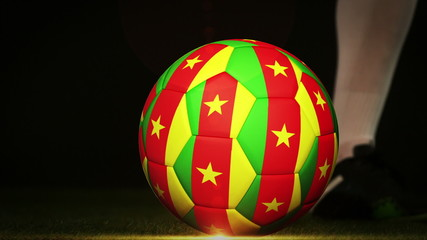 Football player kicking cameroon flag ball