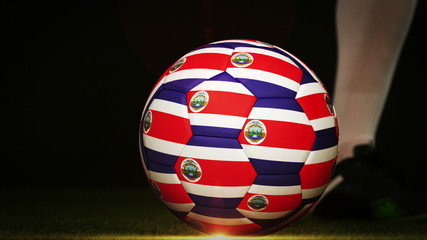 Football player kicking costa rica flag ball