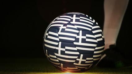 Football player kicking greece flag ball