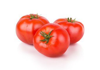 three ripe red tomatoes