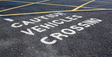 Caution vehicles crossing - warning in car park