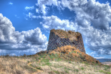 nuraghe under clouds