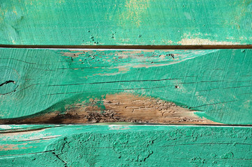Vintage wooden background with green peeling paint