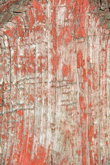 Vintage wooden background with red peeling paint