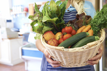 Close Up Of Fresh Produce In Basket At Farm Shop