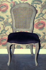 vintage chair furniture against retro decoration wall
