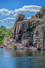 A piece of rock that stands above the water in the river Dnepr
