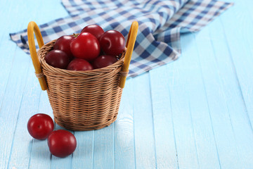 Fresh plums in a wicker basket