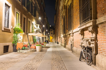 Old street in Milan at night, Italy