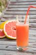 A glass of fresh grapefruit  juice