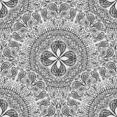 Black and white seamless lace pattern in a primitive style.