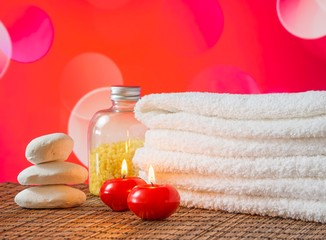 Spa massage with towel stacked candles stone for valentine day