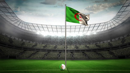 Algeria national flag waving on flagpole in football stadium