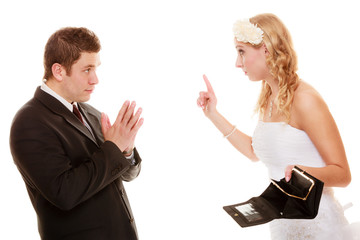 Angry bride with empty purse and groom quarrelling