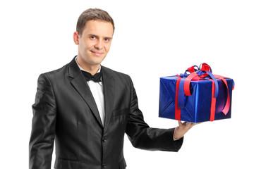Elegant man holding a present