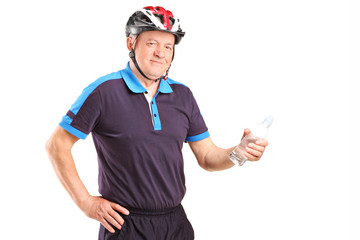 Mature cyclist holding a bottle
