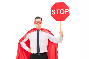 Superhero holding a stop sign