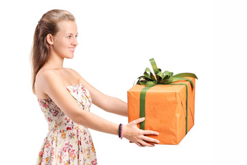 Young woman holding a big present