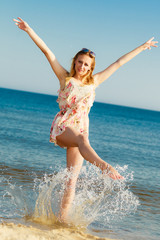 Summer vacation. Girl having fun on the sea coast