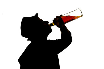 silhouette of alcoholic drunk man drinking whiskey bottle addict