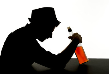 silhouette alcoholic drunk man with whiskey bottle addict