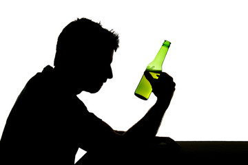 silhouette of alcohol addict drunk man drinking beer bottle