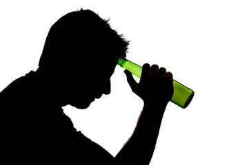 silhouette of alcoholic addict drunk man drinking beer bottle