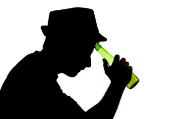 silhouette of alcoholic drunk man drinking beer bottle addicted