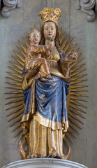 Mechelen - carved and polychromed statue of Madonna