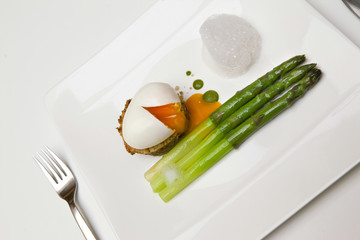 Egg and asparagus on a plate
