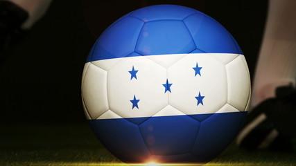 Football player kicking honduras flag ball