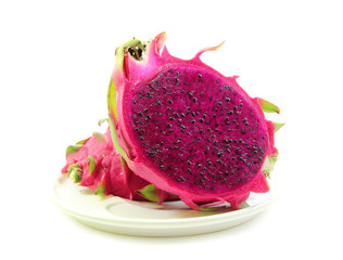 Red dragon fruit in dish on white background