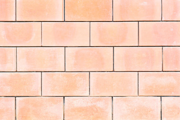 Square orange brick wall background.