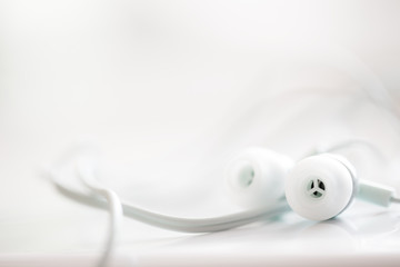White earphones, close up photo, small dof