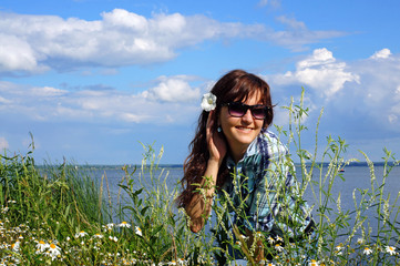 Beautiful girl in wildflowers