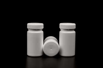 Three supplements bottles