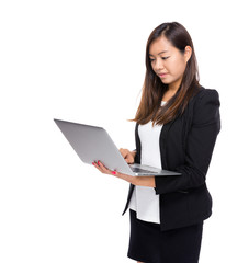 Asian business woman look at notebook computer