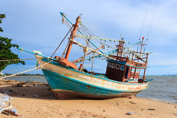 Wooden fishing boat on the beach