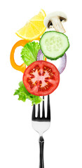 Fresh vegetables on fork