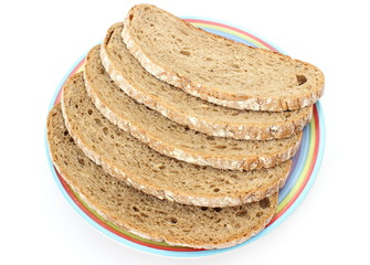 Slices of rye bread and colorful plate
