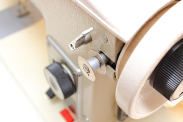 Metal spool of thread with sewing machine