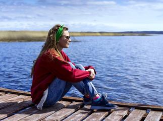 Woman sitting near the lake