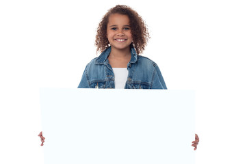 Little girl behind blank whiteboard
