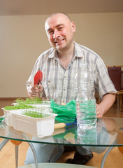 adult man  caring for seedlings