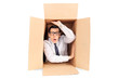 Young businessman trapped in a box